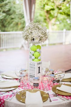 Such a great idea! Hobby Centerpiece with golf and tennis balls @ riverwoodmansion.com | Photo by jenandchriscreed.com | Floral design by enchantedfloristtn.com