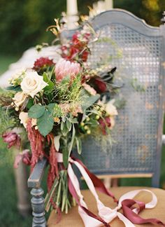 Hand-tied bridal bouquet with rich reds and creams   Secret Garden Wedding Inspiration via @burnettsboards, pic by Travis Kaenel Photography