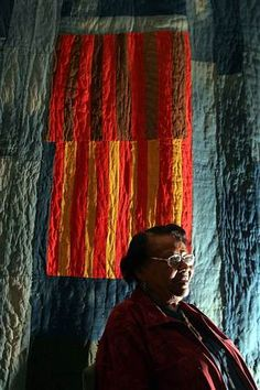 ANNIE MAE YOUNG  |  Gee's Bend quilter Annie Mae Young with her quilt during a media preview of the exhibit: Quilts of Gees Bend at the Museum of Fine Arts in Boston.