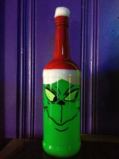 Blacklight holiday bottle. The Grinch. Made from an empty booze bottle and fluorescent paint