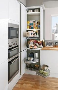 Extra high corner pantry tower with full extension corner storage accessori . Kitchen Corner Units, Tall Kitchen Cabinets, Corner Pantry, Corner Storage, Kitchen Cabinet Storage, Kitchen Layout, New Kitchen, Kitchen Decor, Corner Larder Cupboard