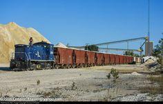 PRLX 3604 (EMD SW1500) loads sand cars at the Carey Quarry Mine.
