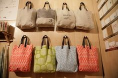 bag display- maybe some door handles on a wooden board that has a stand?