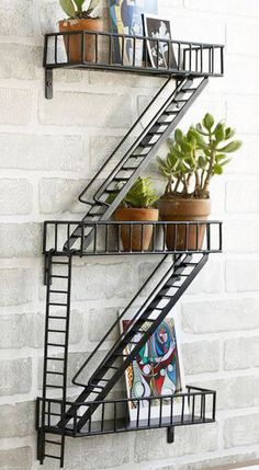 Epoxy-coated steel has been welded by hand to create this hanging industrial shelving piece.