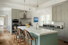 Liz Caan Interiors kitchen. Love the gray cabinets, green island. via Stylebeat