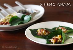 Mieng Kham: Thai street snack. You can substitute the hard to find leaves for romane or even Chrysanthemum  leaves. They have a peppery bite to them. I've also made the sauce by mixing hoisin sauce and sweet chili sauce with some minced dried shrimp and dried coconut. My favorite is the unsweetened toasted coconut shavings from market of choice!