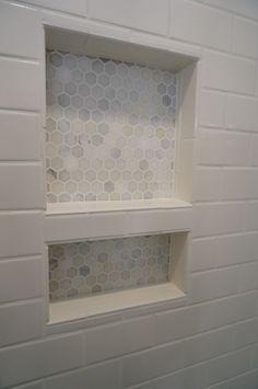 HomeARCH Renovations. Tiled Shower Niche. Carrara hexagon tile.