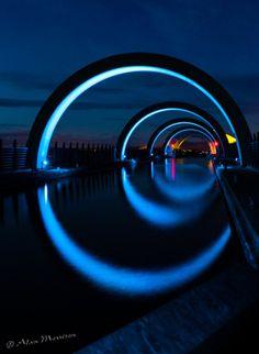 Electric Blue Tunnels across Water. Alan Morrison