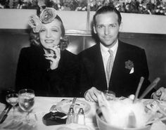 Marlene Dietrich and Douglas Fairbanks Jr enjoying a night out together, 1930s. Doesn't she look like the cat who licked the cream?
