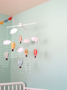 Aqua and Coral--in love with the bright colors of this room, but especially that hot air balloon mobile!