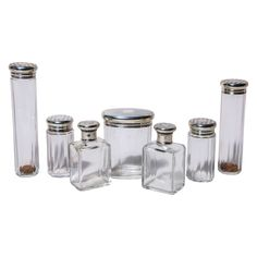 English Art Deco Crystal and Silver Dressing Set, Seven Pieces | From a unique collection of antique and modern apothecary jars and objects at https://www.1stdibs.com/furniture/more-furniture-collectibles/apothecary-jars-objects/