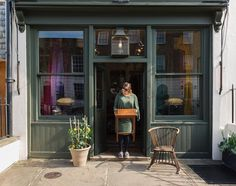 Emily faithfully colour co-ordinating her dress with the front of our shop!