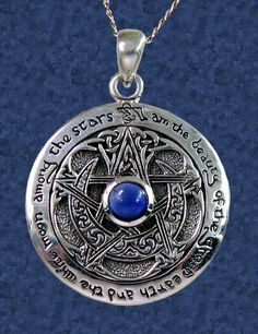 "Sapphire Moon Pentacle Pendant - A heavenly blue sapphire sits at the center of this pendant, framed by a crescent moon woven into the arms of a five-point star. Bordering this unusual pentacle is the text, ""I am the beauty of the green earth and the white moon among the stars."" This sterling silver pendant measures 1"" in diameter, and comes with an 18"" sterling chain. #SterlingSilverPendants-CelticPendantsPaganPendantsCladdaghPendantsUnusualPendantsNaturePendants #Pentacles"