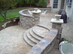Stairs are beautiful features of multi-level patio spaces. Stairs are beautiful features of multi-le Patio Steps, Backyard Patio Designs, Backyard Landscaping, Raised Patio, Patio Layout, Sloped Garden, Concrete Patio, Stamped Concrete, Back Patio