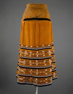 Skirt (Isikhakha or Umbhaco) century Geography:South Africa Culture:Xhosa or Mfengu peoples Medium:Cotton, wool, glass beads, shell buttons, ochre pigment Dimensions:Length in. Xhosa Attire, African Attire, African Wear, African Style, African Outfits, African Women, South African Fashion, African Fashion Designers, African Traditional Wear
