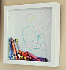 Add a drawing from your child & put crayons in for very cute wall art. Even better is you do it during school supply sales to get those crayons for a steal!