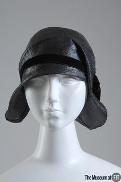 Hat | Caroline Reboux (1870-1956) | France, 1929 | Materials: black straw with black velvet ribbon | The cloche was a revolutionary hat in that it eschewed the rigid wire frames of the 19th century in favor of soft felts and straw, which could be draped and molded to hug the curves of the newly bobbed head | The Museum at FIT, New York