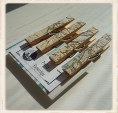 Clothespins decoupaged with recycled maps.