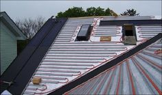integrated solar roof - Metal panels are topped with thin PV laminates but conceal a solar thermal system underneath (made by Dawn Solar Systems).  The surface-mounted PVs generate electricity, but also absorb heat, which is directed into the solar thermal system underneath (but will also melt away snow on top of the roof). Using a closed-loop system of tubes filled with glycol-enhanced water, energy is transferred from the roof to a conventional heating system