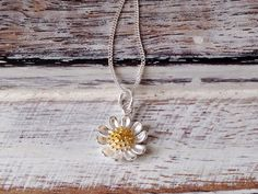 Daisy Chain  ~ Sweet & Summery - cute little daisy chain  ~ Sterling silver three-dimensional daisy charm with gold-plated centre on a very fine 18 sterling silver chain  ~ Perfect little treat or thoughtful gift  ~ Gift boxed ~ Listing is for one necklace  ~ If you would like to see larger Flower Chain as seen in last photo (subject to availability) please follow link: www.etsy.com/uk/listing/280800984/flower-necklaceflower-charmsilver-flower?ref=shop_home_active_1  ~ Please see details…