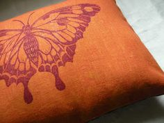 Burnt orange and plum butterfly accent pillow.
