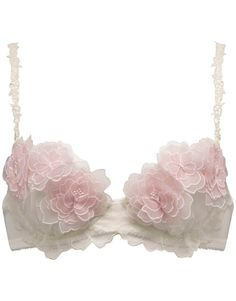 Part of the bridal collection. Ivory lace beneath ivory silk. Light pink flowers in sets of three or four covered the cups made of layered 'tulle' each with a diamond center. The bra would lift and support and tease; serving its purpose all while being beautiful and innocent.