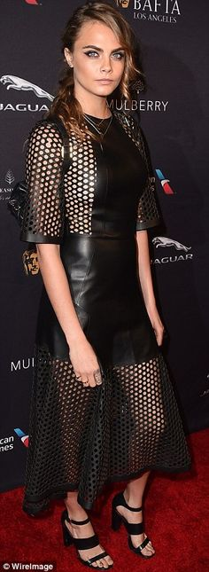 Fashion flair: The supermodel, who favors tight-fitting ensembles, covered up most of her ...