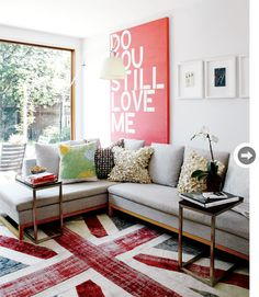 Painted Canvas. Stencil some words. Ta Da! Art!! ;) Also, must find out where that sofa is from!!