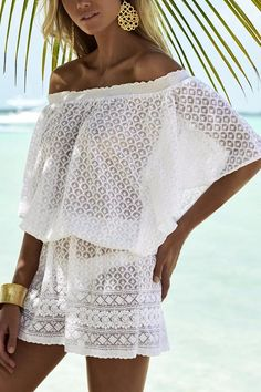 This off the shoulder beach dress is complemented by the flirtatious short hemline, crafted from a lightweight semi-sheer fabric to create a soft dream-like aesthetic. The stunning silhouette is achieved by the loose fitting dress being elasticated at the waist to emphasize the volume in the top and sleeves. - Off-the-shoulder - Elasticized waist - Batwing sleeve - Embroidered - Short -   Michelle Dress White by Melissa Odabash. Clothing - Dresses - Casual Clothing - Dresses - Mini Clothing…