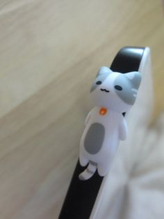 Cute White Cat Laying Dust Plug - earphone plug. $3.48, via Etsy.
