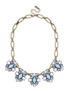A quintet of turquoise diamonds, encrusted in periwinkle jewels, anchors this Caribbean-inspired collar, held together by wide, antique gold links for a modern vintage feel.