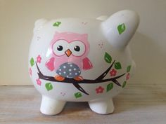 This adorable piggy bank is the perfect addition to any girls bedroom! This is a ceramic piggy, in white with a rubber stopper on the bottom. The measurements are approximately 8 x 7 x7. A sweet owl, branch, leaves and flowers decorates the front of the bank. The childs name, tree, and leaves decorates the back. Colors for this bank can be customized! Please message me prior to ordering.  When ordering: -Select your lettering choice from drop down menu (sample shows whimsy) -Include the…