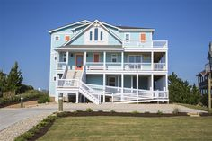 """SUNRISE CAY, Cottage #059 l Duck, NC - Outer Banks Vacation Rental Home l Built in 2015 - Oceanfront in Carolina Dunes and offering 7 bedrooms (5 master suites), elevator, billiard lounge, den with sports bar, private saltwater pool, hot tub, """"Rum Shack"""" cabana bar with outdoor TV, corn hole, private beach walkway and more! l www.CarolinaDesigns.com"""