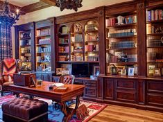 Study with lighted bookcases