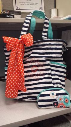 Thirty-One - Spring 2014 - Retro metro bag in navy wave print, with orange personalization.