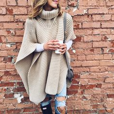 comfy turtleneck knit poncho, ripped jeans, and hunter boots