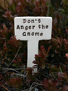 """Don't Anger the Gnome"" garden sign."