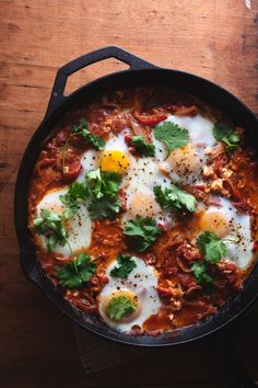 """Shakshuka"" is popular in Tunisia and other North African countries. it contains eggs, tomatoes, onions, and spices. the name ""Shakshuka"" means ""mixture"" in Arabic. Read Recipe by Good_Lifestyle New Recipes, Vegetarian Recipes, Cooking Recipes, Favorite Recipes, Healthy Recipes, Cooking Ham, Cooking Tomatoes, Cooking Pasta, Cooking Pumpkin"