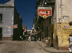Street in San Juan, Puerto Rico by Jack Delano captures a vibrant island in a time of transition, with American influence (via Coca Cola sign) weighing in...