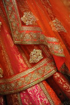 Pure brocade and kundan work lehenga choli in orange color. For more collection visit our website www.panachehautecouture.co.in