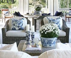Wicker seating with crisp white cushions provides  a casual, summery foundation for an outdoor  space. Cluster chairs around a low cocktail table  to create a conversation spot that's just as  inviting as any indoor living area.