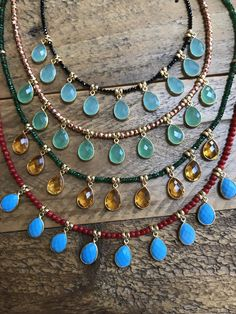 """Natural high quality coral stones set with genuine turquoise drops. This beautiful necklace is designed with a specific length that allows you to wear it alone and stack well with other pieces. The drops move with your movement. Gold-filled accent beads & clasp. Length 20"""""""