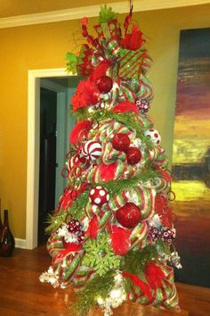 Christmas tree with beautifully decorated with red and green decor.
