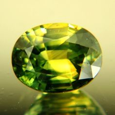 Gemstone: Natural Sapphire - Carat: 2.98 - Comment: Grass green and hay yellow untreated sapphire from Australia. Nice size, strong natural color. Golden and shimmering. A good gem for individual jewelry and a nice addition to a natural sapphire collection.  http://wildfishgems.com/inc/sdetail/8553