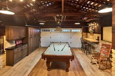 This is a garage; it's also an incredible game room and den. To cozy up the…