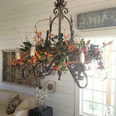 Love Joanna Gaines' chandelier wreath! Cut one end of wreath to fashion around chandelier