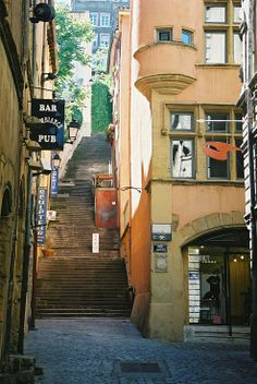"""The """"traboules"""" (hidden passageways) of Lyon, France. Setting for The Silk Romance, by Helena Fairfax Hidden Passageways, Ef Tours, Lyon France, Destination Voyage, Safe Haven, Stairway To Heaven, Rhone, Stairways, Italy Travel"""