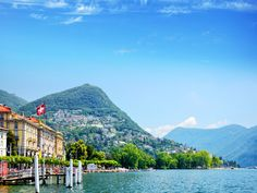 Lake Lugano Lugano, The Alps water outdoor mountain sky Boat mountainous landforms landform geographical feature body of water Lake mountain range Nature fjord Sea vacation loch reflection landscape bay docked vehicle alps reservoir glacial landform surrounded day