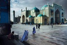 Salat at Blue Mosque, 2004, Steve McCurry: This is a photo of an absolutely beautiful Mosque in Afghanistan.  You can see the color blue repeated throughout the photo, which brings the whole photo together with a gorgeous sense of unity.  I think that the goal of this photo was to show how beautiful these Islamic Mosques and artworks can be, and to promote the beautiful side of Islam.  You see the themes of the Middle East and Islam repeated often in McCurry's works.