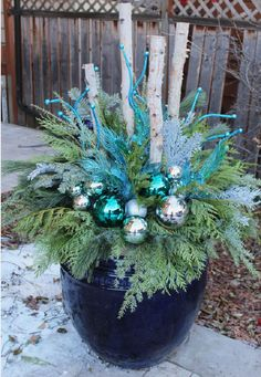 35 Festive outdoor holiday planter ideas to decorate your porch for Christmas - Home Decoration Outdoor Christmas Planters, Christmas Urns, Silver Christmas Decorations, Christmas Projects, Winter Christmas, Christmas Home, Christmas Wreaths, Christmas Ideas, Blue Christmas
